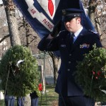 Photo by Lt. Col. Jo Stys - Cadet 2nd Lieutenant Michael Leggett  from Milwaukee Composite Squadron #5, placing the Air Force ceremonial wreath at Wood National Cemetery.