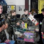 Photo by:  2nd Lt John Winter - Cadets from Sheboygan Composite Squadron assist a family picking out presents at the annual Toys-for-Tots event.