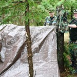 Photo by Maj Les Wright:  Two Sheboygan cadets as they finish their emergency shelter.