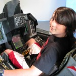 IMG1369.jpg - Joe Parent, a student at Sparta Meadowview Middle School, takes a ride in the F-16 simulator.  Photographer - Autumn Grooms, Sparta Area SD - 5x7