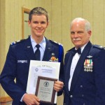 Photo by First Lieutenant Carolyn Johnson – Cadet Major David Feig, receives his Wisconsin Wing Cadet of the Year Award from Colonel Clarence Peters, Wisconsin Wing commander.