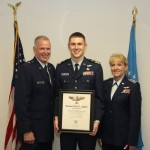 Brigadier General John McCoy (left) presents the Spaatz Award to Cadet Colonel Michael Ebert, CAP's highest cadet award, along with Lieutenant Colonel Rose Hunt, Wisconsin Wing vice-commander.